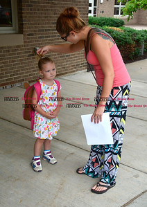 9/1/2016 Mike Orazzi | Staff Emily Cara and her daughter Maya on the first day of school Thursday morning at the Ivy Drive School in Bristol. Maya is going into pre-k.