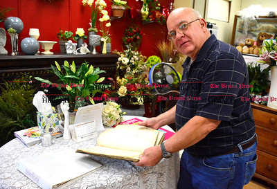 9/1/2016 Mike Orazzi | Staff Dave Allaire  with the 100 year old ledger at Hubbard's Florist in Bristol.