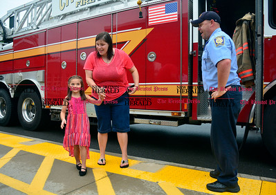9/1/2016 Mike Orazzi | Staff Kindergartener Olivia Westbrook and her mom Michelle with firefighter Chris Haden Thursday morning at the Ivy Drive School in Bristol. Olivia was chosen as the lottery winner for annual ride to school.