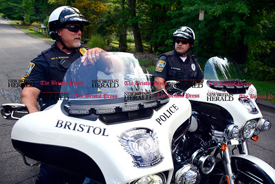9/1/2016 Mike Orazzi | Staff  Bristol Police Sgt. Russ Marcham and patrolman Craig O'Connor on the city's motorcycles Thursday.