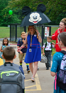 9/1/2016 Mike Orazzi | Staff Ivy Drive School Principal Rosie Vojtek guides students on the first day of school Thursday.