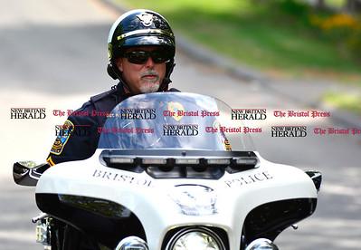 9/1/2016 Mike Orazzi | Staff  Bristol Police Sgt. Russ Marcham on Tuttle Road in Bristol Thursday.