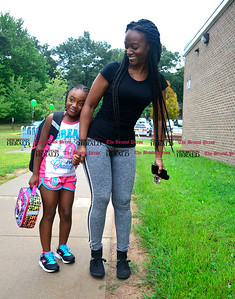 9/1/2016 Mike Orazzi | Staff  Kwantica Federick and her daughter Karalena on the first day of school at the Ivy Drive School in Bristol Thursday morning.