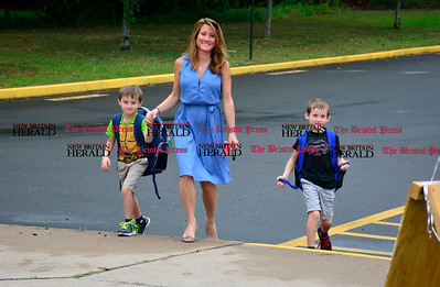 9/1/2016 Mike Orazzi | Staff  Katherine Case and her sons Cole and Parker arrive on the first day of school at the Ivy Drive School in Bristol Thursday morning.