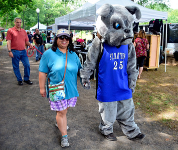 9/3/2016 Mike Orazzi | Staff Michele Faraci and the St. Matthew School mascot during the 2nd annual Bow Wow Bark in the park held in Bristol's Rockwell park on Saturday.