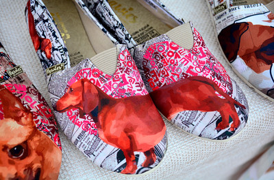 9/3/2016 Mike Orazzi | Staff Dachshund slippers for sale during the 2nd annual Bow Wow Bark in the park held in Bristol's Rockwell park on Saturday.
