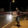 090916  Wesley Bunnell | Staff<br /> <br /> Stephen Schafer of New Britain holds a sign warning drivers turning onto Paul Manaforte Drive of a DUI checkpoint staged just up the road by the CCSU police department. Cars heading up Paul Manaforte Drive were directed through the DUI checkpoint into a campus parking lot then back onto the road.