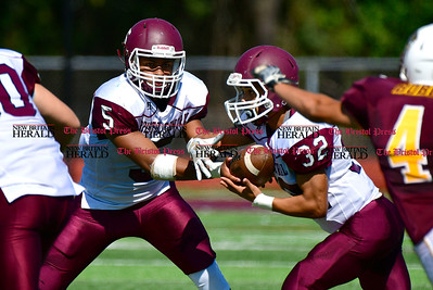 9/17/2016 Mike Orazzi   Staff Bristol Central's Isaiah Miller (5) and Luis Medina (32) in South Windsor on Saturday.