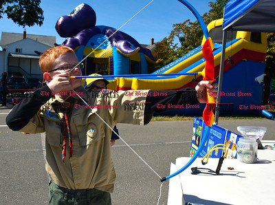 9/16/2016 Mike Orazzi   Staff Adam Krueger shoots a bow and arrow while at the Immanuel Lutheran's one day German Festival Saturday in Bristol.