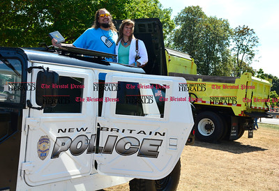 9/16/2016 Mike Orazzi   Staff Glen Calvin Thomas Fahey and Diane Sal check out police vehicles during Main Street USA, in New Britain's Walnut Hill Park Saturday.