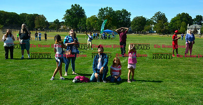 9/16/2016 Mike Orazzi   Staff Part of the crowd gathered to watch for sky divers during Main Street USA, in New Britain's Walnut Hill Park Saturday.