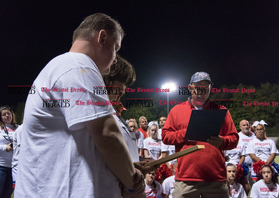 091616  Wesley Bunnell   Staff  Frank and Michelle Zuk, parents of Nick Zuk, listen as head Berlin High School football coach and State Representative Joe Aresimowicz speaks during a ceremony to honor Nick who passed away in June after a battle with Leukemia. A monument was unveiled near the entrance to the football field in Nick's honor on Friday evening before their game vs Rockville with a ceremony presentation at the games conclusion..