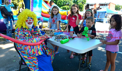 9/16/2016 Mike Orazzi   Staff Flower while making balloon animals during Immanuel Lutheran's one day German Festival Saturday in Bristol.