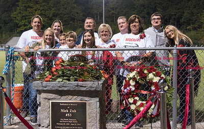 091616  Wesley Bunnell   Staff  A monument was unveiled Friday evening near the entrance to the Sage Park football field to honor Nick Zuk, a Berlin HS student and football player,  who lost his battle with Leukemia this past June.  Nick's parents Frank and Michelle are third and fourth from the right. They are surrounded by family members.