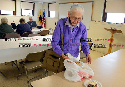 9/16/2016 Mike Orazzi   Staff Jane Dzielinski looks through a bad with the four deserts she bought during Immanuel Lutheran's one day German Festival Saturday in Bristol.