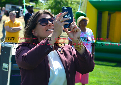9/16/2016 Mike Orazzi   Staff New Britain Mayor Erin Stewart while watching sky divers during Main Street USA, in New Britain's Walnut Hill Park Saturday.