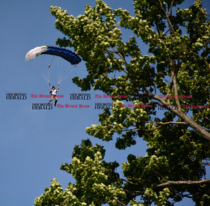 9/16/2016 Mike Orazzi   Staff Sky diver Doug Hendrix makes his entrance during Main Street USA, in New Britain's Walnut Hill Park Saturday.
