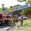 092616  Wesley Bunnell | Staff<br /> <br /> Ladder truck #3 in front of  286 Lewis Rd on Monday afternoon after a fire broke out at the residence.