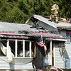 092616  Wesley Bunnell   Staff<br /> <br /> Firefighters walk on the roof of 286 Lewis Rd in New Britain on Monday afternoon after extinguishing a house fire.
