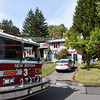 092616  Wesley Bunnell | Staff<br /> <br /> Ladder truck #3 in front of  286 Lewis Rd on Monday afternoon with firefighters on the roof after a fire broke out at the residence.