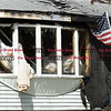 092616  Wesley Bunnell | Staff<br /> <br /> The front entrance to 286 Lewis Rd in New Britain on Monday afternoon after a home fire was extinguished.