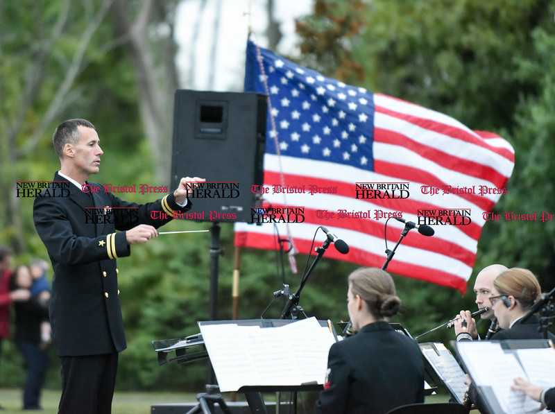 092916  Wesley Bunnell | Staff<br /> <br /> Director of Navy Band Northeast LT Gregory A. Fritz leads the band as they perform for a crowd in Berlin at Veteran's Memorial Park on Wednesday evening.