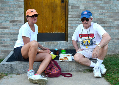 9/10/2016 Mike Orazzi | Staff Patti and Jack Slason eat in the shade during the St. Stanislaus Church's annual Dozynki celebration on West Street in Bristol Saturday.