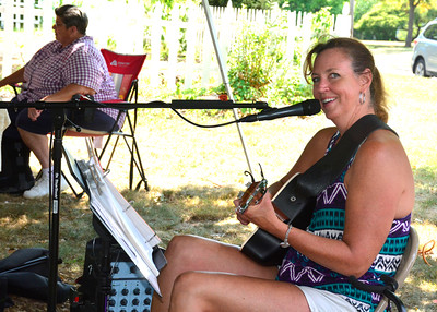 9/10/2016 Mike Orazzi | Staff Liz Friedmann provides entertainment during the Berlin tag sale and farmers market held at the Hungerford Park Nature Center on Saturday.