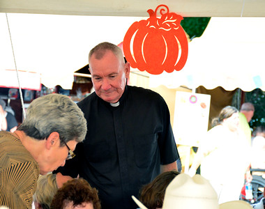 9/10/2016 Mike Orazzi | Staff Fr. Raymond S. Smialowski during the St. Stanislaus Church's annual Dozynki celebration on West Street in Bristol Saturday.