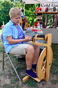 9/10/2016 Mike Orazzi | Staff Cold Goats Farm Vivienne McGarry spins yarn from her goats during the Berlin tag sale and farmers market held at the Hungerford Park Nature Center on Saturday.