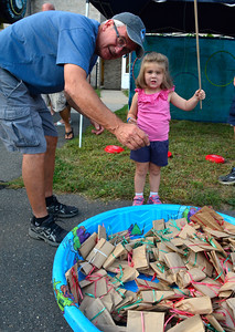 9/10/2016 Mike Orazzi | Staff Scott Thompson and his grand daughter Mary while fishing during the St. Stanislaus Church's annual Dozynki celebration on West Street in Bristol Saturday.