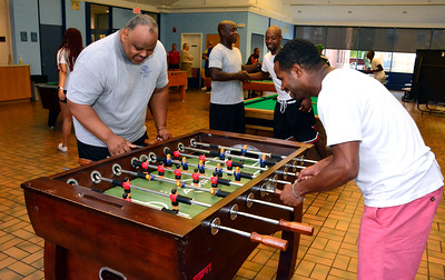 9/10/2016 Mike Orazzi | Staff Berwyn Kelley and Labone Holley play Foosball during the Boys and Girls Club of New Britain's 125th anniversary picnic while trying establish an alumni association to help support the organization on Saturday.