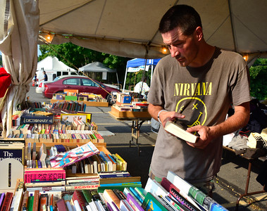 9/10/2016 Mike Orazzi | Staff Jason Colson looks through the books at the tag sale during the St. Stanislaus Church's annual Dozynki celebration on West Street in Bristol Saturday.