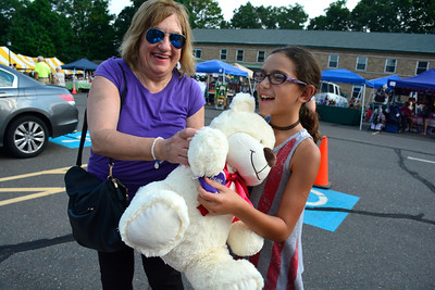 9/10/2016 Mike Orazzi | Staff Debbie Nappi and her grand daughter Kayla with a large bear Kayla won during the St. Stanislaus Church's annual Dozynki celebration on West Street in Bristol Saturday.