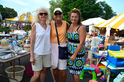9/10/2016 Mike Orazzi | Staff Jan Marineau, Sandy Pelletier and Donna Bruzas at the tag sale during the St. Stanislaus Church's annual Dozynki celebration on West Street in Bristol Saturday.