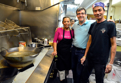 9/14/2016 Mike Orazzi | Staff  Sabaidee Thai Restaurant's Sengdeune Singmavong, Peter Dion and Longtze Seng in the kitchen of the new downtown restaurant.
