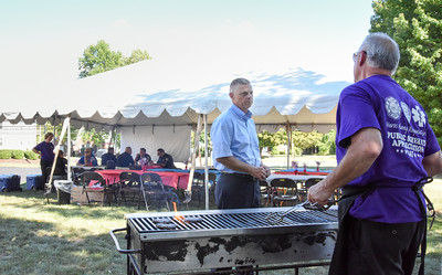 091316  Wesley Bunnell | Staff  New Britain Memorial-Sagarino Funeral Home held a cookout in appreciation for New Britain's Police,Fire & EMS workers on Tuesday afternoon from 1-5 adjacent to the home.  Police Commissioner Howard Dyson, center, speaks with cookout volunteer Don Sagarino.