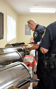 091316  Wesley Bunnell | Staff  New Britain Memorial-Sagarino Funeral Home held a cookout in appreciation for New Britain's Police,Fire & EMS workers on Tuesday afternoon from 1-5 adjacent to the home.  Lt. John Rodriguez at one of the food stations set up indoors.