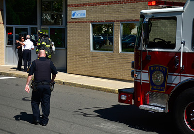 9/14/2016 Mike Orazzi | Staff Members of the Bristol fire department on scene of an odor of gas at 32 Valley Street in Bristol. Employees were evacuated as a safety precaution after 30 people were taken to the hospital last week after carbon monoxide poisoning at the same location last week.