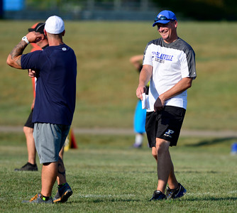 9/1/2015 Mike Orazzi | Staff Plainville High School Coach Chris Farrell during a scrimmage at St. Paul on Tuesday.