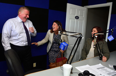 9/14/2016 Mike Orazzi | Staff Bristol Mayor Ken Cockayne and New Britain Mayor Erin Stewart during a visit to The Beat radio station in Bristol Wednesday morning. On the right is Amy Sunshine.