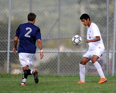 9/16/2016 Mike Orazzi | Staff Bristol Central's Jonathan Cabrera (12) and Wethersfield's Chris Scacca (2) during soccer in Bristol Friday afternoon.