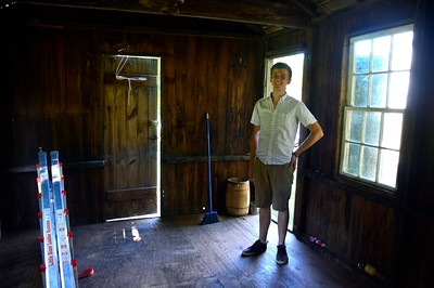 9/22/2016 Mike Orazzi | Staff Tom Vaughn while working on renovating Plymouth's historic schoolhouse that was moved to South Main Street recently.