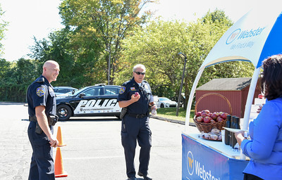 092216  Wesley Bunnell | Staff  Webster Bank held Berlin Police Appreciation Day on Thursday from 11:00 to 3:00 p.m at the Webster Square Road location. Officers could stop by for pizza from the Family Pizza Truck as well as healthy snacks for the road. Lieutenants Chris Ciuci , left, and James Gosselin grab apples before leaving. The event was organized by Branch Manager and Vice President Ana Osypuk.