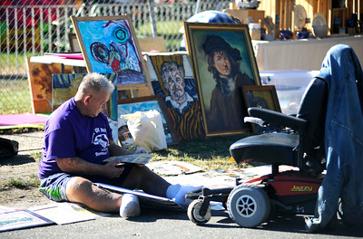 9/24/2016 Mike Orazzi | Staff Gary Fortier with his artwork during the Bristol Mum Festival on Saturday on Memorial Blvd.