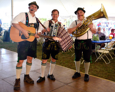 "9/24/2016 Mike Orazzi | Staff Sha-Musi's Ron Kwas, Fred Meier and Tommy ""Tuba"" Donza during the Oktoberfest at St. Peter Church in New Briatin Saturday."