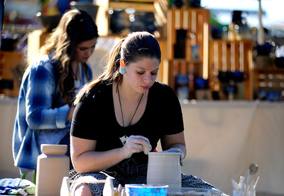 9/24/2016 Mike Orazzi | Staff Poor Girls Pottery's Amy Sciongay (right) and Erika Novak during the Bristol Mum Festival on Saturday on Memorial Blvd.