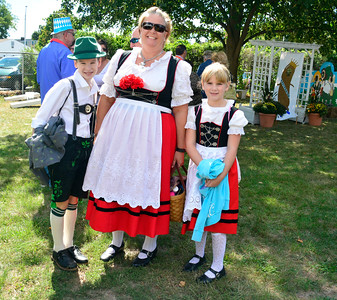 9/24/2016 Mike Orazzi | Staff Leslie Libby (center) with Patrick and Grace during the Oktoberfest at St. Peter Church in New Britain Saturday.