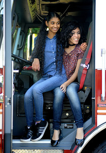 9/24/2016 Mike Orazzi | Staff Viannie Rivera and Guaika Villafane sit in the driver's seat of a Bristol Fire Department truck during the Bristol Mum Festival on Saturday on Memorial Blvd.