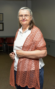 090816  Wesley Bunnell | Staff  Betty Catelli poses with a linen yarn stole made by another class member at the Sit & Knit Class on Thursday afternoon at the Berlin-Peck Memorial Library.
